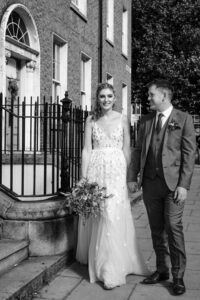 Wedding photographer in Dublin photographs the bride and groom pictured walking through Georgian Dublin