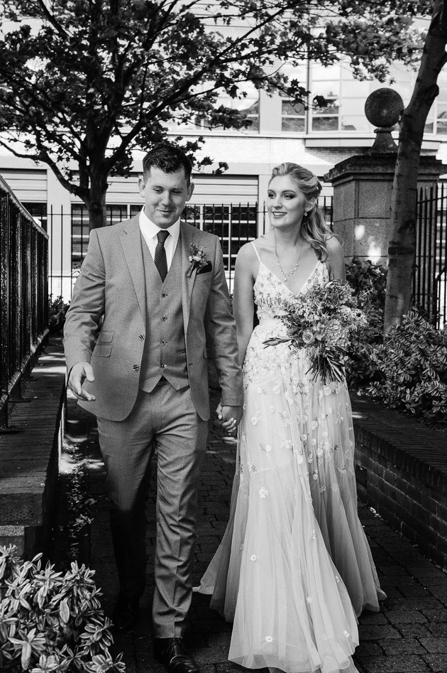 The bride and groom arrive for their micro wedding at The Dublin Registry Office