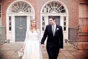 The bride and groom pictured in Georgian Dublin in a Dublin Christmas Wedding Photograph
