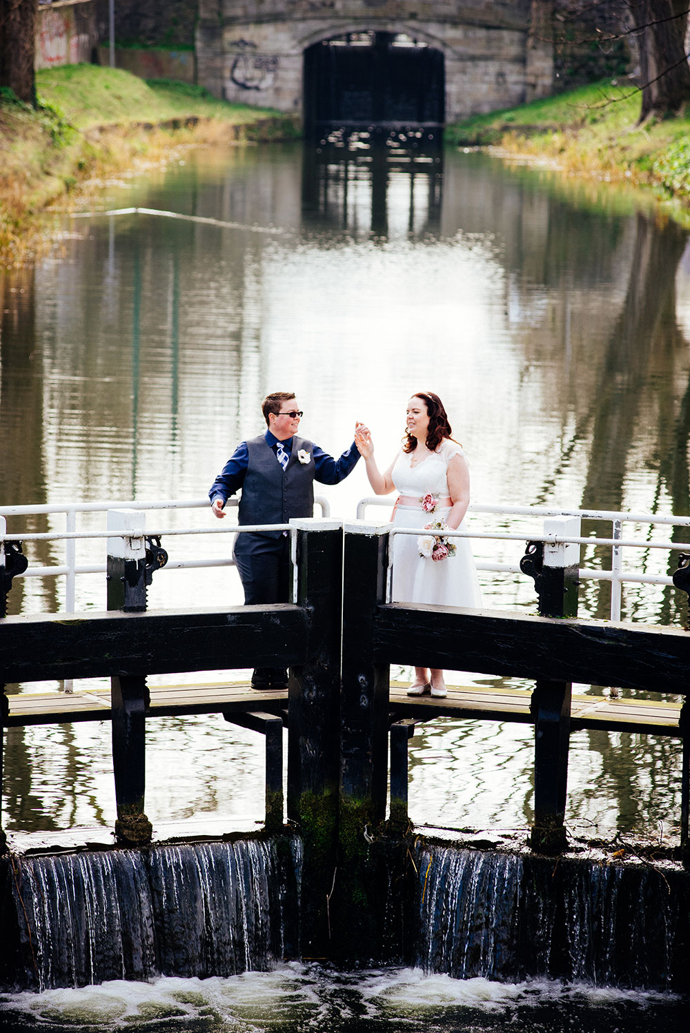 A couple photographed standing on the lock crossing the Grand Canal during their LGBT Dublin Wedding