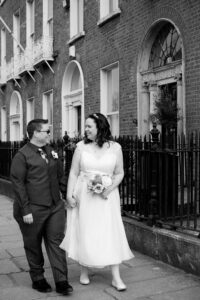 A couple walk through Georgian Dublin during their LGBT Gay wedding