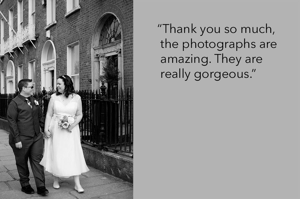 A couple walk through Georgian Dublin during their LGBT Gay wedding