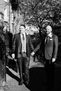 Two grooms photographed walking through Georgian Dublin during their LGBT Gay Wedding
