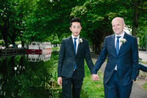 Two grooms photographed standing on the locks crossing the Grand Canal in Dublin during their LGBT Gay Wedding.