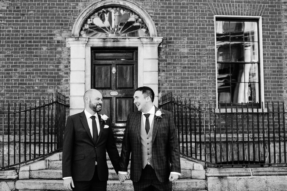 Two grooms photographed in front of Georgian doors on Merrion Road in Dublin during their LGBT Gay Wedding