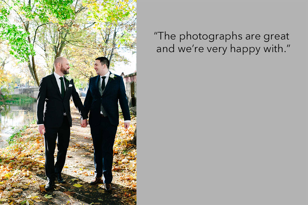 LGBT Wedding Photo of two grooms walking along the banks of the Grand Canal in Dublin following their wedding at the Dublin Registry Office