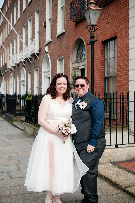 LGBT Wedding Photographer in Dublin photographs a couple walking through Georgian Dublin on their wedding day.