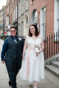 LGBT Wedding Photographer Dublin photographs a couple walking through Georgian Dublin on their wedding day.