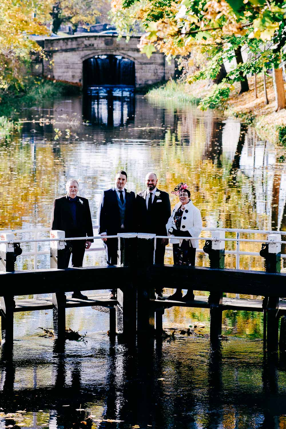 Two grooms and their family pictured on the lock crossing the Grand Canal in Dublin after their LGBTQ Wedding at the Dublin Registry Office.
