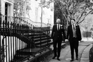 LGBTQ Wedding Photographer photographs two grooms walking through Georgian Dublin on their wedding day.