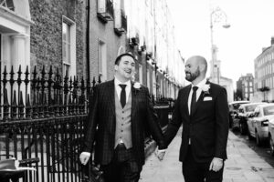 LGBTQ Wedding Photography of two grooms walking through Georgian Dublin after being married at the Dublin registry office.