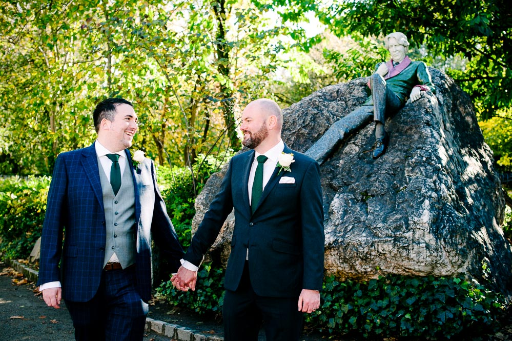 LGBTQ Wedding Photography at the statue of Oscar Wilde in Merrion Square park in Dublin