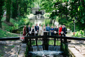 Guests at a micro wedding in Dublin pictured on the lock crossing the Grand Canal in Dublin