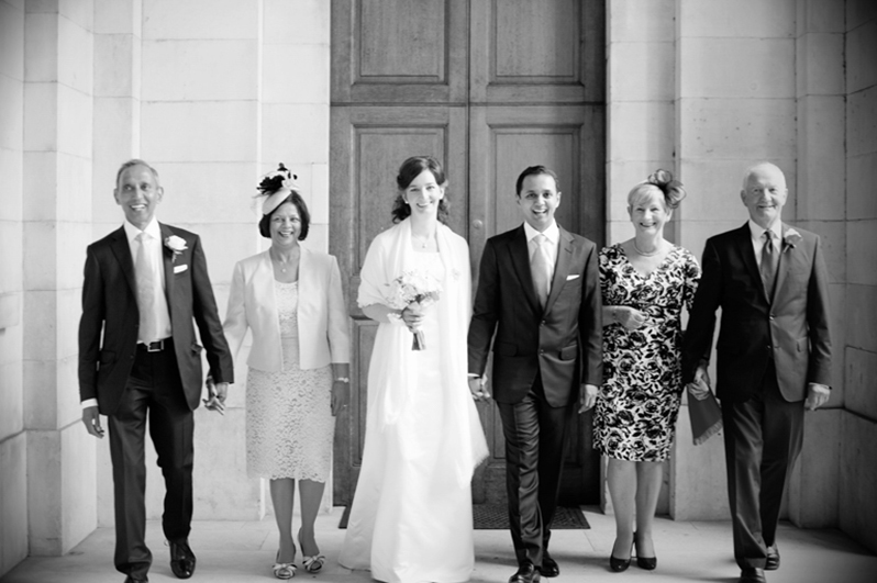 Family Wedding photo outside Trinity College Chapel