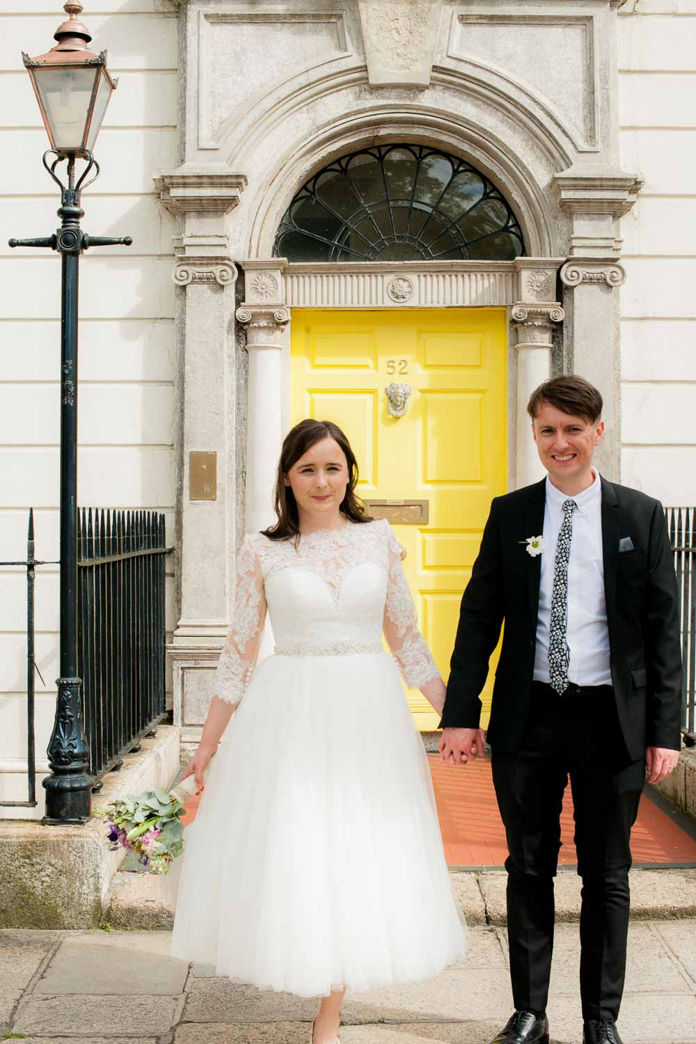 Registry Office Photography of the bride and groom standing at a Georgian door in Dublin
