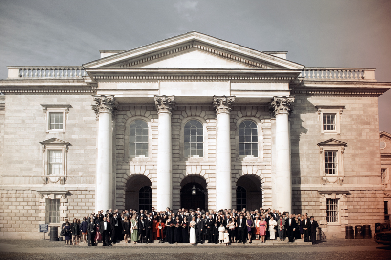 Wedding photograph on the steps of Trinity College Chapel