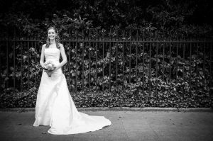 The bride poses for a wedding photograph by St.Stephen's Green in Dublin before her Fallon & Byrne Wedding Ceremony