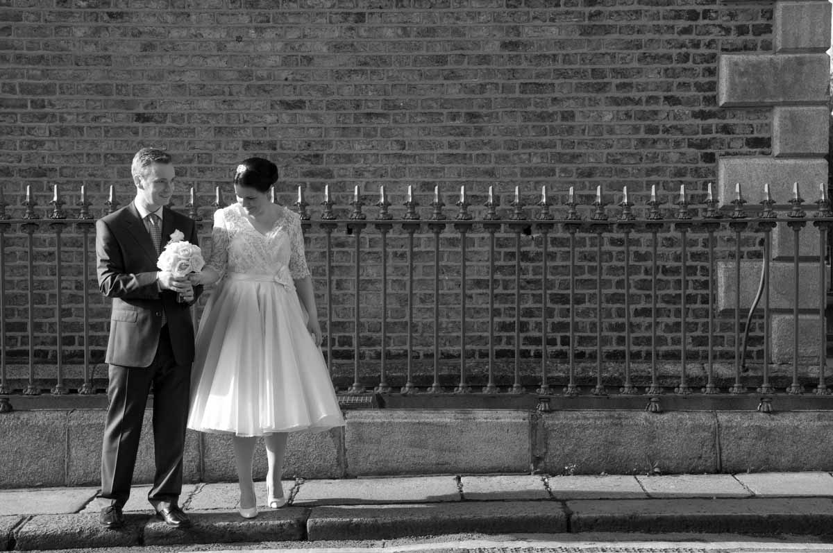 The bride and groom pose for some Registry Office Wedding Photography around Georgian Dublin before their registry office wedding