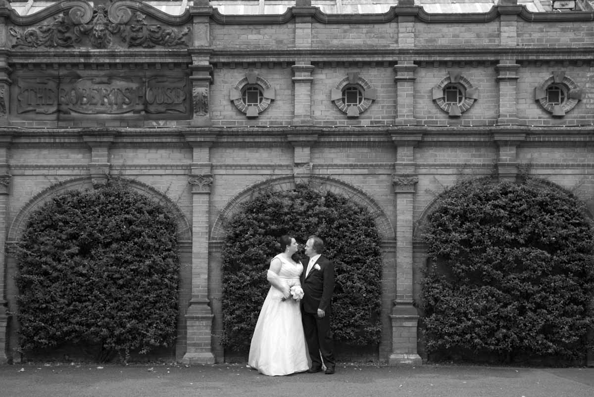 The bride and groom pose for a Zoo wedding photograph in the grounds of Dublin Zoo