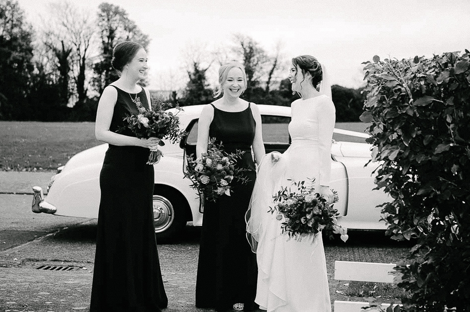 The bride and bridesmaids getting ready to leave for her Clontarf Castle Wedding