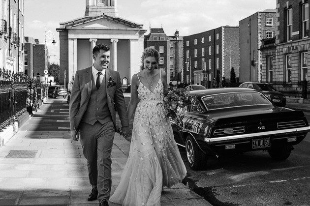 The bride and groom walk through Georgian Dublin after being married at the Registry Office
