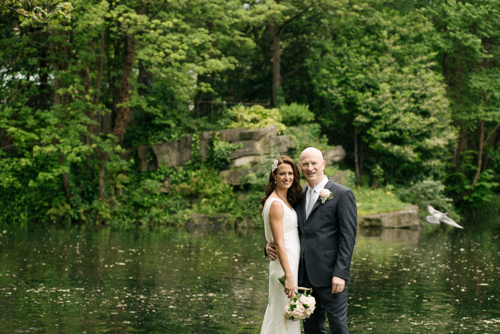 The bride and groom pose for a wedding photograph in St. Stephen's Green during their Shelbourne Hotel Wedding