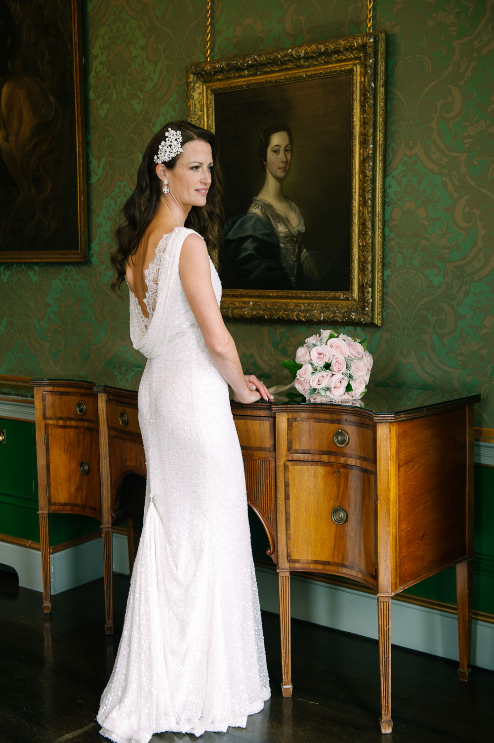 The bride poses for a wedding photograph in The Constitution Room during her Shelbourne Hotel Wedding