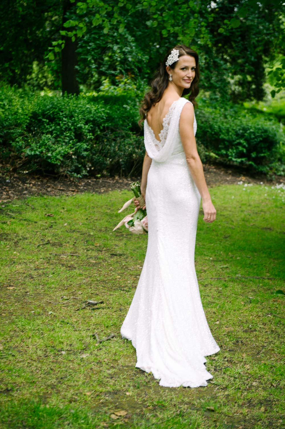 The bride poses for a wedding photograph in St. Stephen's Green during her Shelbourne Hotel Wedding Reception