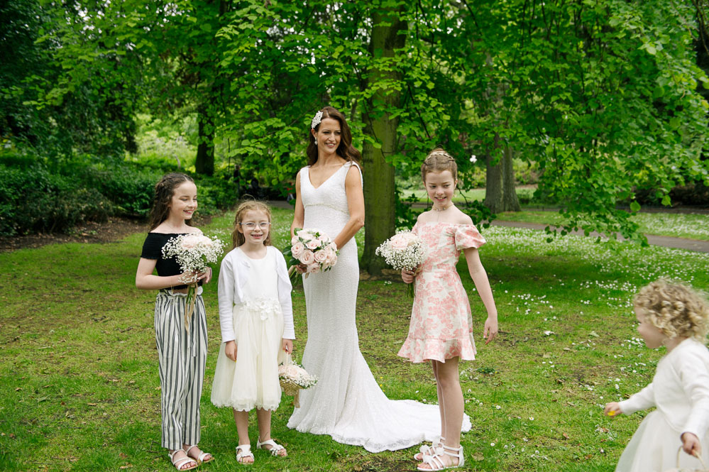 The bridal party pose for a wedding photo in St. Stephen's Green Dublin