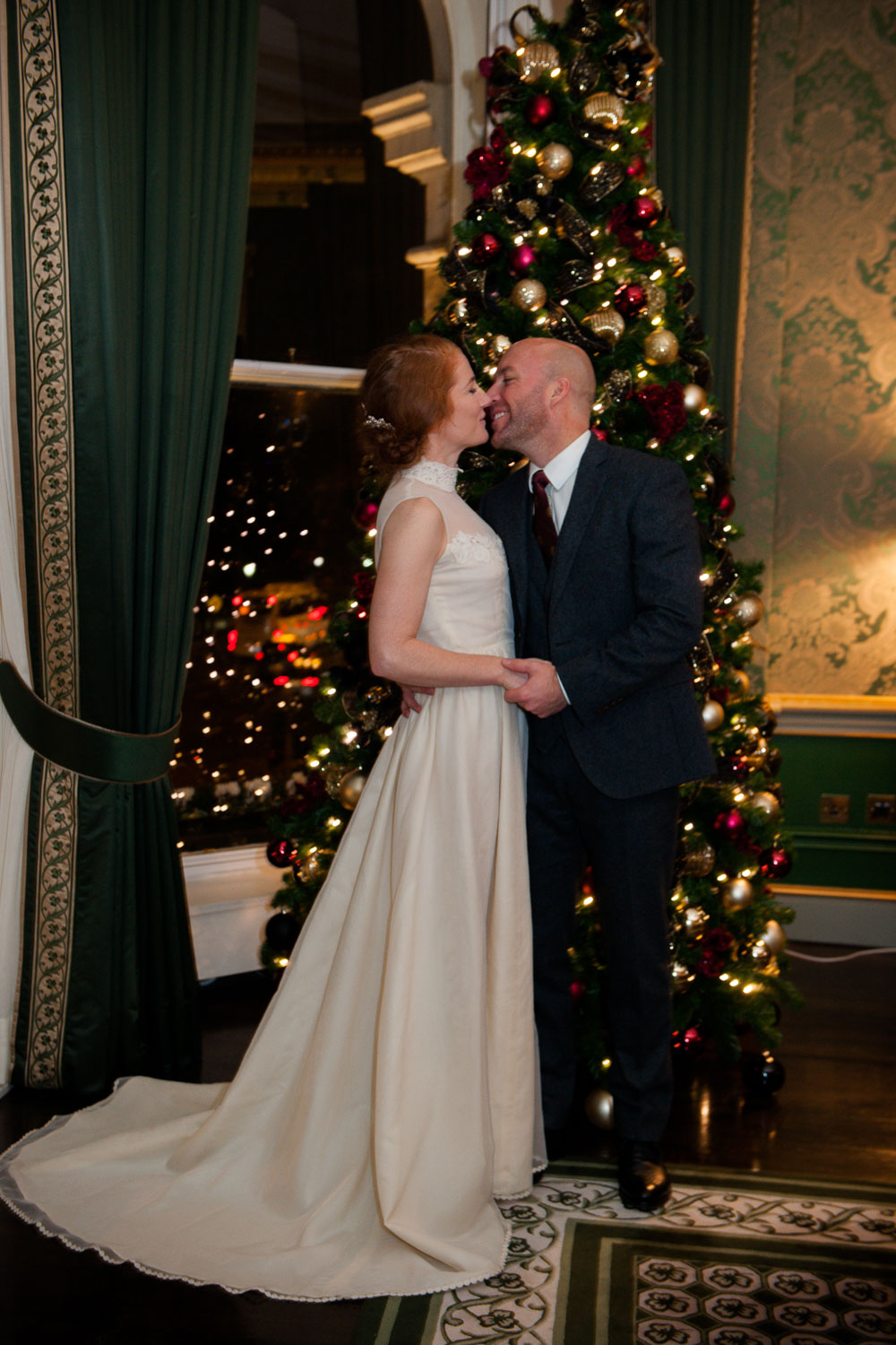 The bride and groom photographed at the Christmas Tree during their Shelbourne Hotel Christmas Wedding