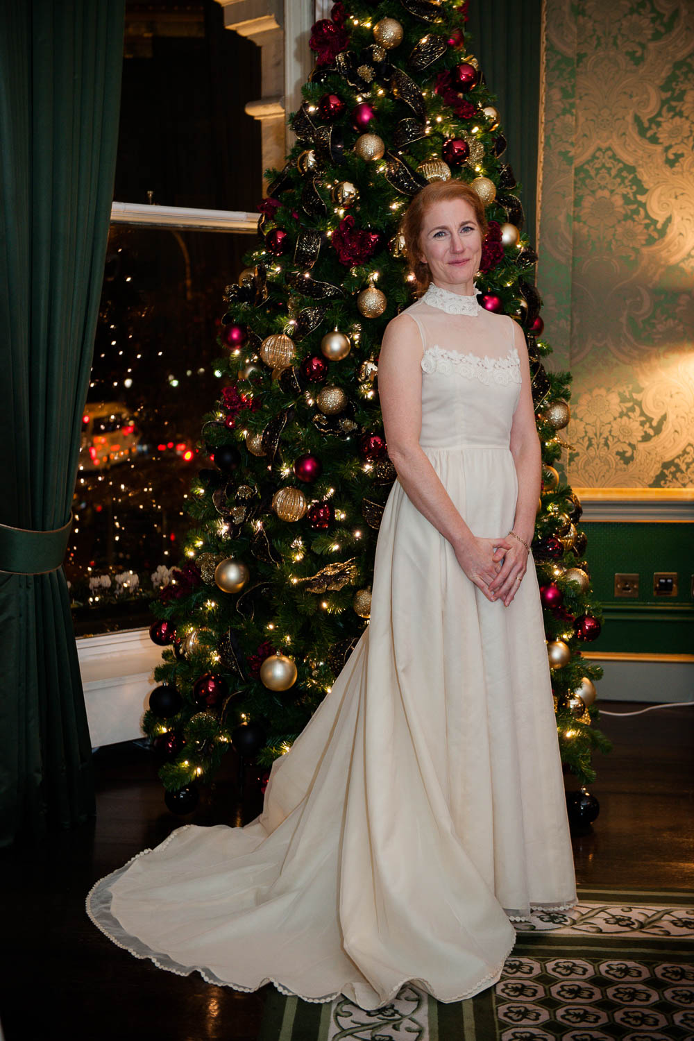The bride poses by the Christmas tree for Shelbourne Hotel Wedding Photograph