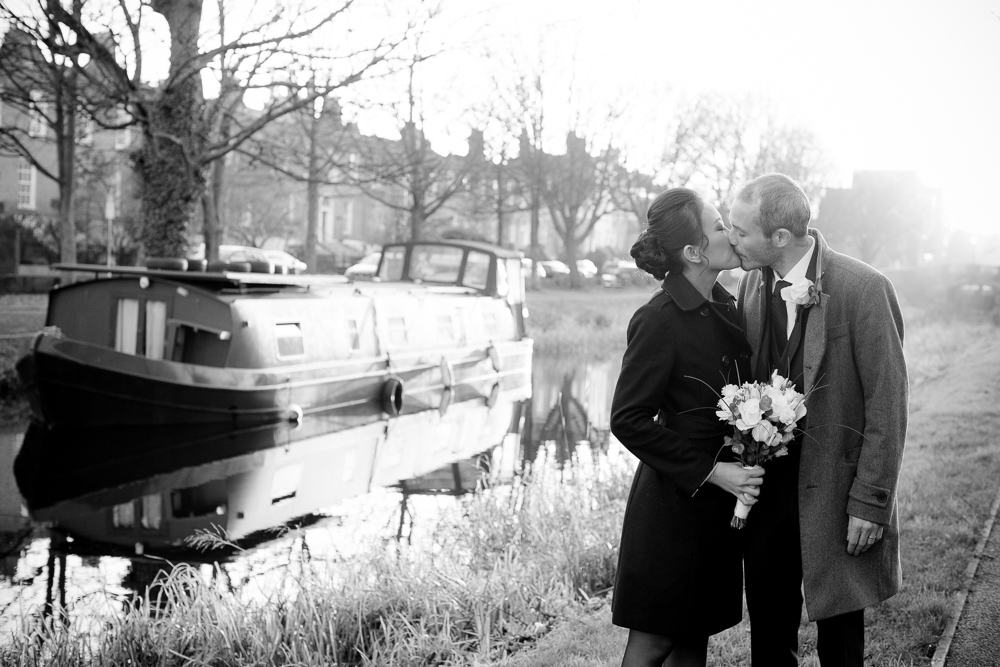 The bride and groom by the banks of the grand canal in a Registry Office Wedding Photograph