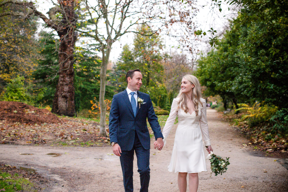The bride and groom take a walk through Merrion Square Park hand in hand before their Merrion Hotel wedding