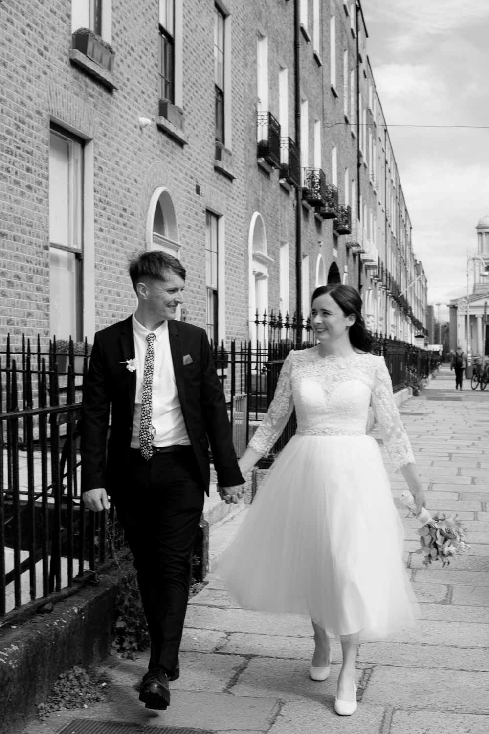 Registry Office Photography of the bride and groom walking through Georgian Dublin following their wedding ceremony
